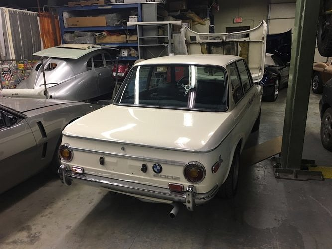 Checking out a BMW 2002 for sale